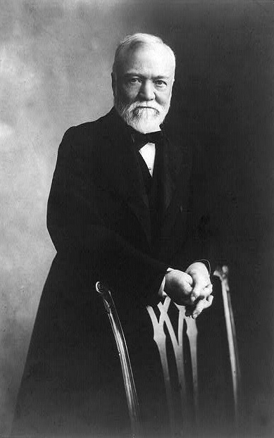 """Davis & Sanford, N.Y. """"Andrew Carnegie, Three-Quarter Length Portrait, Standing Behind Chair, Facing Front."""" ca. 1905. Prints and Photographs Division, Library of Congress (USA)."""
