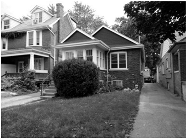 """Bungalow, Leslieville, with a """"double villa"""" or duplex beside it. Spring 2010. Photograph by the author."""