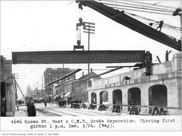 Queen St East and Canadian National Railway grade separation, placing first girder, 1 p.m., (Way Department) Creator: Alfred J. Pearson, December 5, 1926