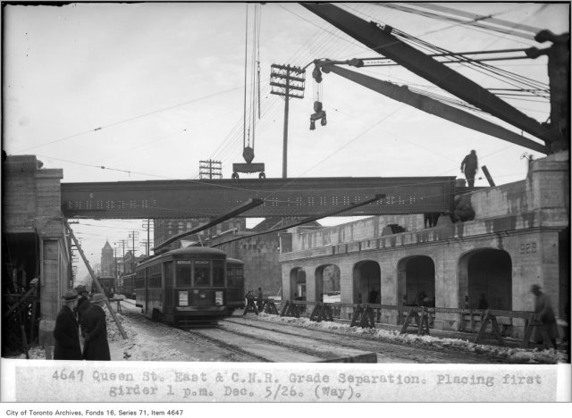 Queen St East and Canadian National Railway grade separation, placing first girder, 1 p.m., (Way Department) Creator: Alfred J. Pearson Date: December 5, 1926