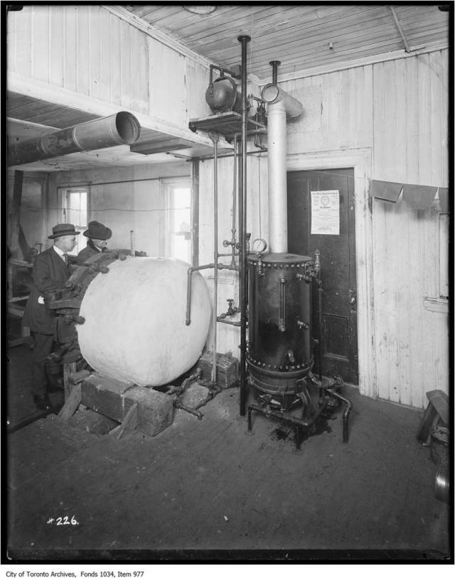 Gas-fired steam boiler assists the Never Worry Interlock Casingette oven for making rubber automobile tire protective casings City of Toronto Archives