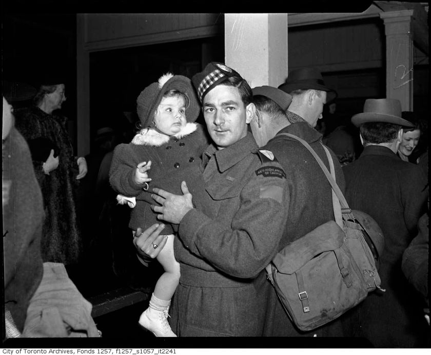 48th-highlander-soldier-holding-child-1940s