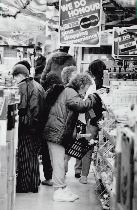 bargain-harolds-coxwell-and-gerrard-dec-16-1990-photo-by-peter-power-toronto-star-toronto-star-license-accessed-at-the-toronto-public-library