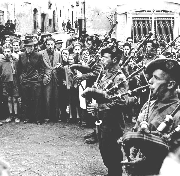 pipers-of-the-48th-highlanders-of-canada-play-in-campobasso-shortly-after-its-capture-18-october-1943-canada-dept-of-national-defence
