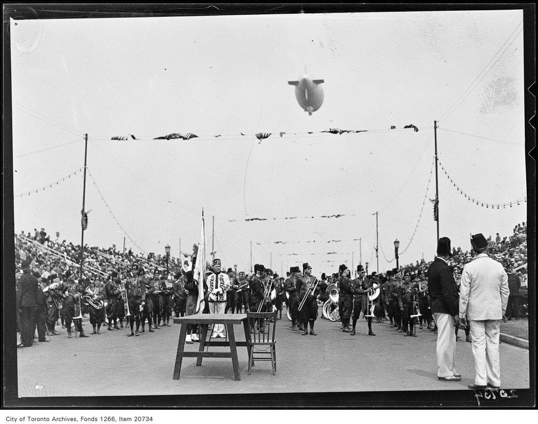 Shrine Peace Parade, Parade on Boulevard, blimp overhead.