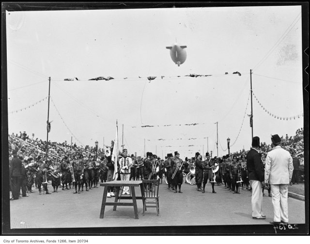 Shrine Peace Parade, Parade on Boulevard, blimp overhead.