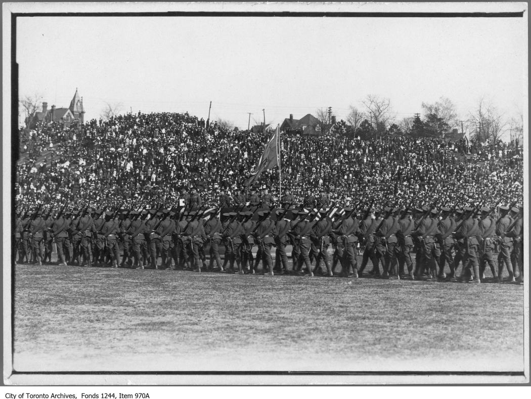 Soldiers march past reviewing stand, Riverdale Park. - 1914