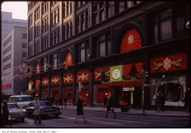 View of front of Simpson's with holiday decorations, Yonge and Queen Street West