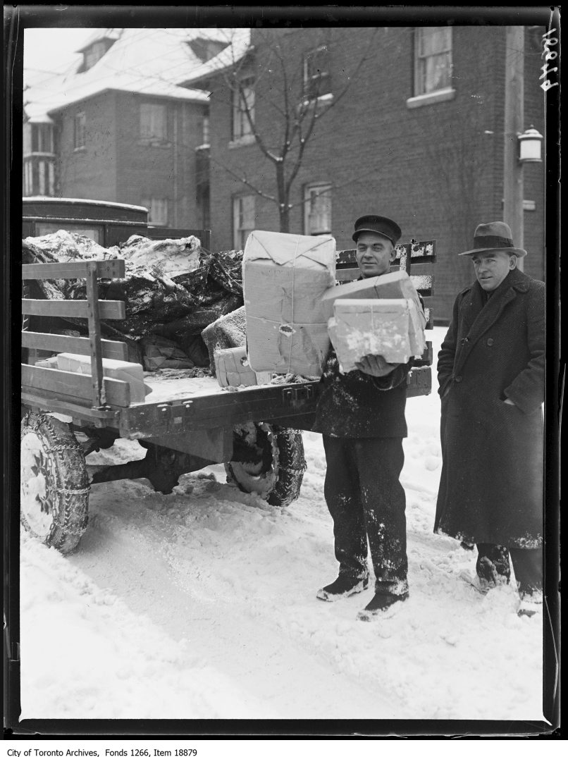 Postman with truck. - December 25, 1929