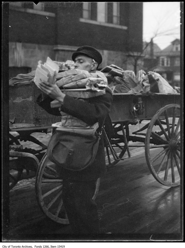 Xmas day, mailman with load of mail. - December 25, 1928