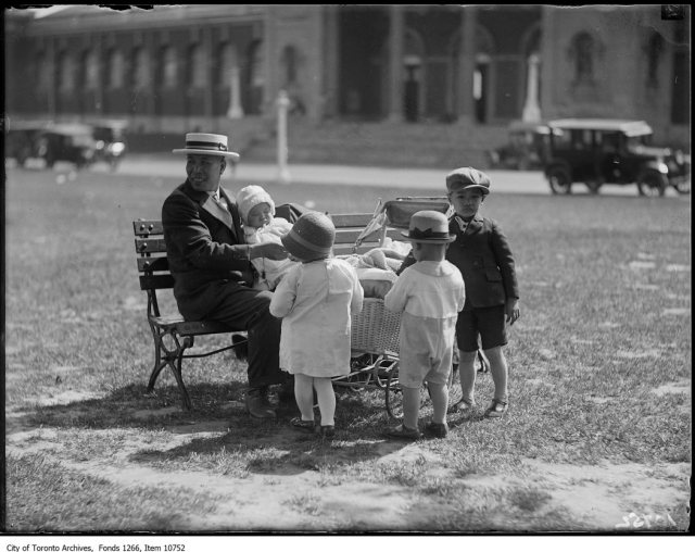 Chinese Picnic, father & children on bench. - June 17, 1927
