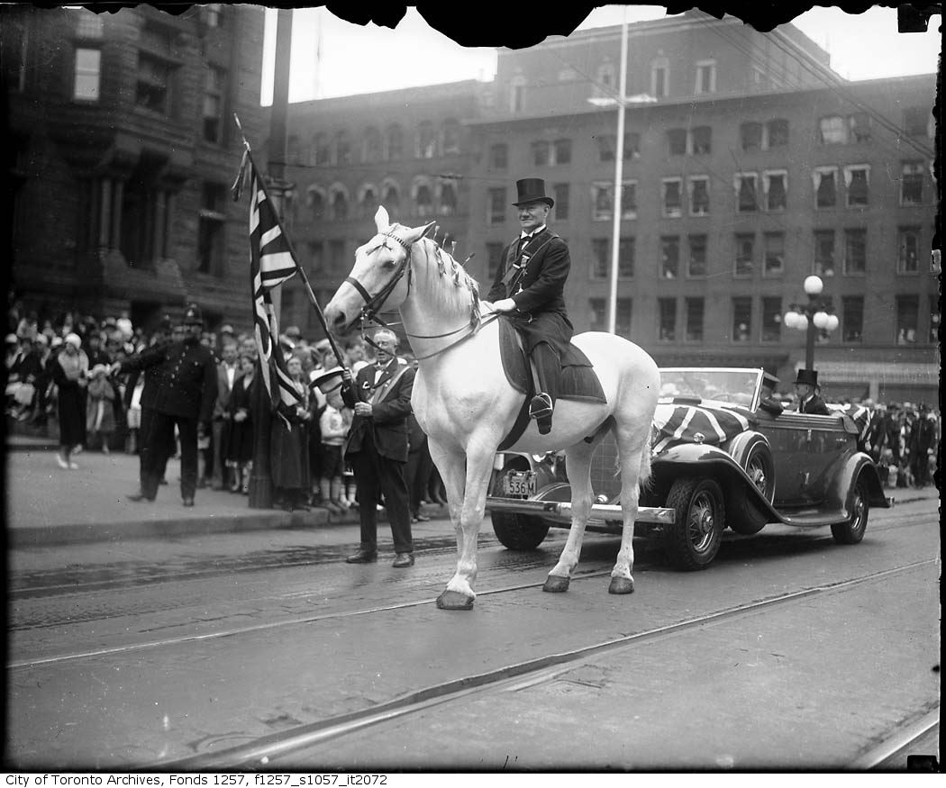 Marshall W. H. Harper on horse in Orange Parade, Queen Street West, July 12, 1932, Alexandra Studio fonds