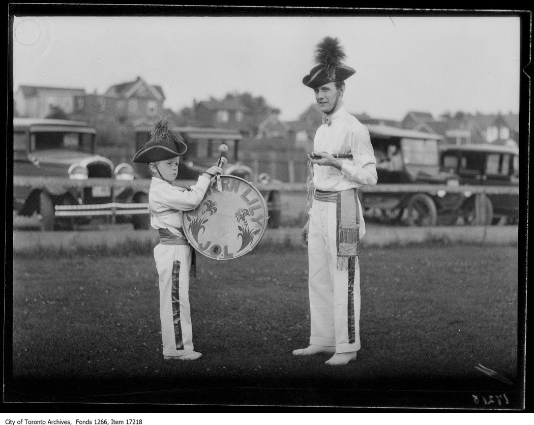 Orange bands, bandmaster and youngest boy. - July 8, 1929