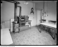 Residential kitchen with gas lighting, Vulcan gas range and auxiliary coal stove 1917