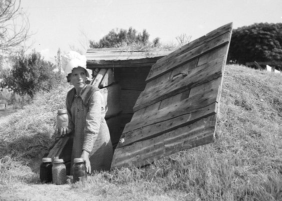 """Woman, preserves and her root cellar. Root cellars or """"root houses"""" also served as storm shelters."""