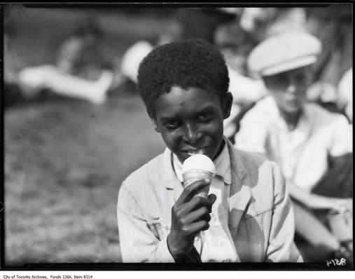 Boy eating ice cream Victoria Park School, July 21, 1926